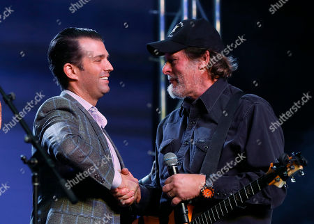 Donald Trump Jr., left, shakes hands with Ted Nugent during a rally for Republican U.S. Senate candidate John James in Pontiac, Mich