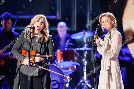 Alison Krauss, Kelsea Ballerini. Alison Krauss, left and Kelsea Ballerini perform at the 2018 CMT Artists of the Year show at the Schermerhorn Symphony Center, in Nashville, Tenn