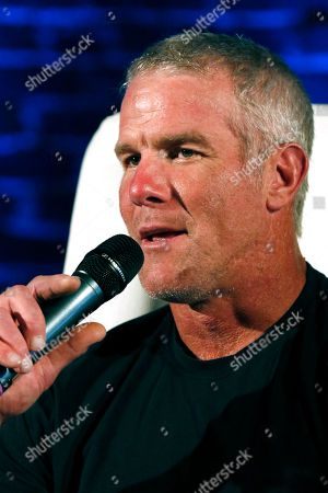 NFL Hall of Fame quarterback Brett Favre participates in a question and answer session at a fundraiser for Willowood Developmental Center, a facility that provides training and assistance for special needs students, in Jackson, Miss. Favre, whose mother has a degree in special education, said he is a few hours short of graduating from Southern Mississippi and is being encouraged by his mother to obtain his degree