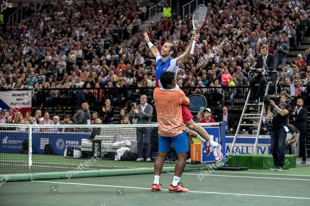 Indian tennis player Leander Paes (down) jokes with Czech tennis player Radek Stepanek (up) during Stepanek's farewell exhibition match, which officially ends his career in Prague, Czech Republic, 18 October 2018.