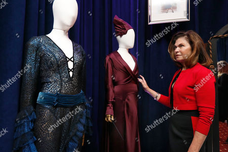 "Colleen Atwood appears with two of her designs from ""Fantastic Beasts: The Crimes of Grindelwald,"" during a preview of the Neiman Marcus Christmas Book in New York, . The Oscar-winning costume designer will design a custom piece and treat two for the day to lunch, swag and a possible film set tour of whatever project she might be working on at the time for $300,000"