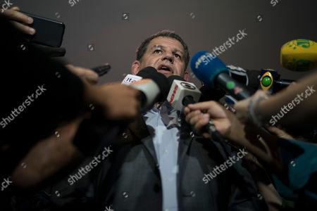 Gustavo Bebianno Rocha, president of the Social Liberal Party, speaks to journalists in Rio de Janeiro, Brazil, . A Brazilian leftist presidential candidate leftist Fernando Haddad is accusing his far-right adversary, Jair Bolsonaro of the Social Liberal Party, of electoral fraud for allegedly allowing friendly businessmen to secretly pay to spread slanderous messages. Rocha tried to deflect the blame to Haddad and the Workers' Party