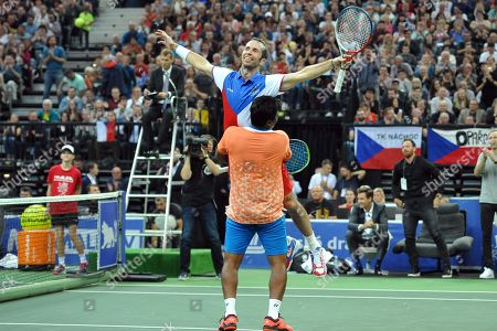 Double winner of Davis Cup Radek Stepanek say goodbye to his tennis career on October 18 at the O2 arena in Prague in the Czech Republic. On photo celebrate victory with Leander Paes of India.