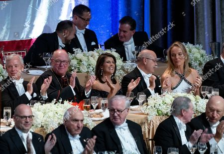 Keynote speaker Ambassador to the United Nations Nikki Haley, center, shares a light moment as she attends the 73rd Annual Alfred E. Smith Memorial Foundation Dinner, in New York. Center left is Archbishop of New York Cardinal Timothy Dolan, and right center is Michael Haley, husband of Nikki Haley