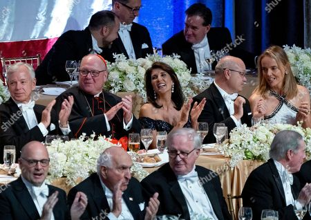 Keynote speaker Ambassador to the United Nations Nikki Haley, center, shares a light moment as she attends the 73rd Annual Alfred E. Smith Memorial Foundation Dinner, in New York. Left center is Archbishop of New York Cardinal Timothy Dolan, and right center is Michael Haley, husband of Nikki Haley