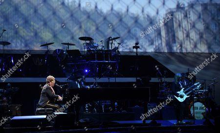 "Elton John, Davey Johnstone. Singer/songwriter Elton John performs onstage during his ""Farewell Yellow Brick Road"" final tour at Madison Square Garden, in New York"