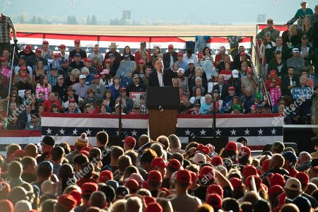 Sen. Steve Daines addresses the crowd at Minuteman Aviation Hangar at the Missoula International Airport in Missoula, Mont.,, before the arrival of President Donald Trump. Trump is in Missoula to rally support for Senate candidate Matt Rosendale