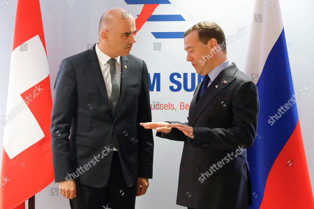 Stock Picture of Swiss Federal President Alain Berset, (L), and Russian Prime Minister Dimitry Medvedev, (R), during a bilateral meeting at the Asia-Europe Meeting (ASEM), in Brussels, Belgium, 19 October 2018. Heads of state and governments from 51 European and Asian countries will discuss on the theme 'Europe and Asia: global partners for global challenges'.