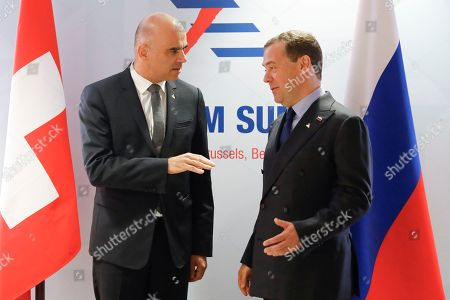 Stock Image of Swiss Federal President Alain Berset, (L), and Russian Prime Minister Dimitry Medvedev, (R), during a bilateral meeting at the Asia-Europe Meeting (ASEM), in Brussels, Belgium, 19 October 2018. Heads of state and governments from 51 European and Asian countries will discuss on the theme 'Europe and Asia: global partners for global challenges'.