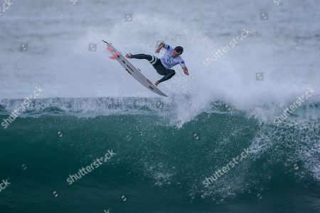 Australia's surfer Julian Wilson rides a wave during the MEO Rip Curl Pro Portugal 2018 surfing event as part of the World Surf League (WSL) at Praia dos Supertubos in Peniche, Portugal, 19 October 2018.