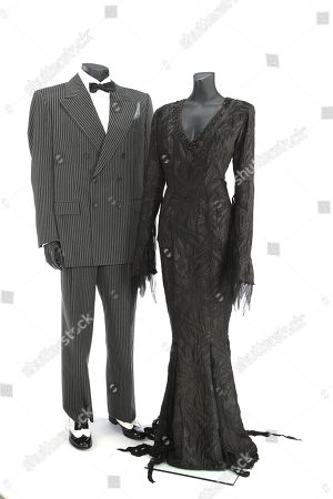 Gomez Addams' (Raul Julia) signature suit from Barry Sonnenfeld's dark comedy The Addams Family Values, and Morticia Addams' (Anjelica Huston) classic gown from The Addams Family and The Addams Family Values.