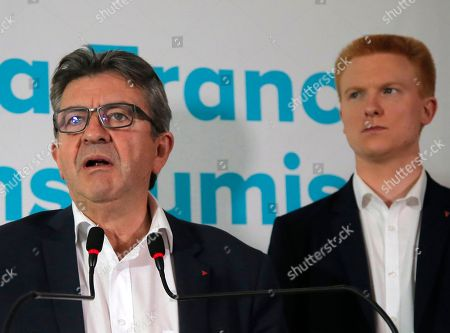 French far-left leader Jean-Luc Melenchon, left, flanked by parliament member Adrien Quatennens, speaks during a press conference in Paris, Friday, Oct.19, 2018. Melenchon, a 2017 presidential candidate, has now landed him in trouble, with prosecutors going after the leader of the France Unbowed party for verbally savaging anti-corruption investigators
