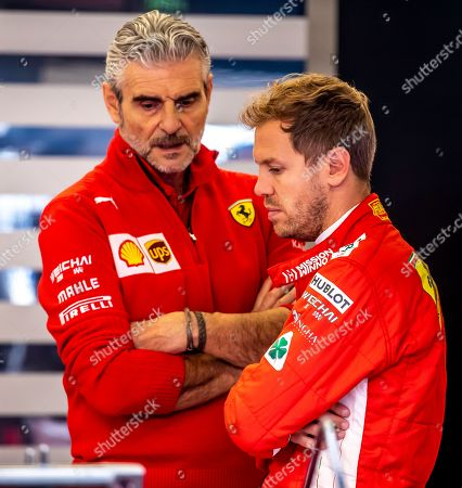 German Formula One driver Sebastian Vettel (R) of Scuderia Ferrari chats with the team principal Maurizio Arrivabene (L) during the second practice session at the Circuit of the Americas, in Austin, Texas, USA, 19 October 2018. The United States Formula One Grand Prix takes place on 21 October 2018.