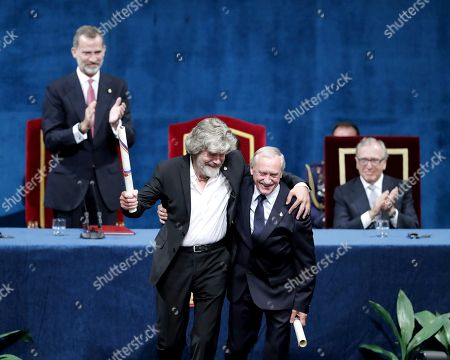 Stock Photo of Spanish King Felipe VI (L) awards Italian alpinist Reinhold Messner (C-L) and Polish alpinist Krzysztof Wielicki (C-R) with the Princess of Asturias Award of Sports 2018 during the 38th edition of the Princess of Asturias Awards ceremony at the Campoamor Teather in Oviedo, Asturias, northern Spain, 19 October 2018. The Princess of Asturias Awards are given every year to personalities or organizations from all around the world who make significant achievements in the sciences, arts, literature, humanities and sports.