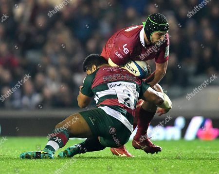 Tom Price of Scarlets is tackled by Tatafu Polota-Nau of Leicester Tigers