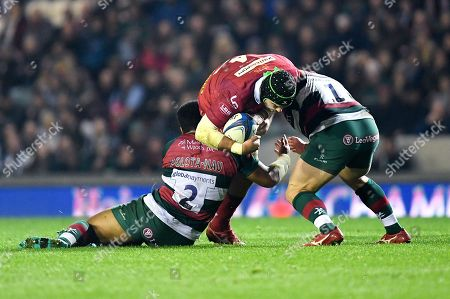Tom Price of Scarlets is tackled by Tatafu Polota-Nau and Greg Bateman of Leicester Tigers