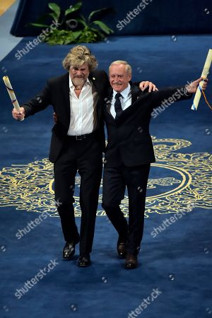 Stock Picture of Reinhold Messner, Krzyzsztof Wielicki. Reinhold Messner of Italy and Krzyzsztof Wielicki from Poland, right, gesture after receiving Princess of Asturias Award Sport from Spain's King Felipe VI at a ceremony in Oviedo, northern Spain