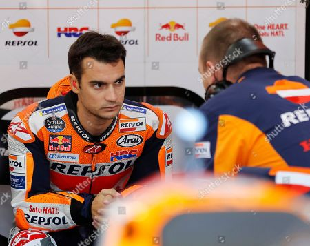Spanish MotoGP rider Dani Pedrosa (L) of Repsol Honda Team talks with team members as he prepares for the qualifying session of the MotoGP Motorcycling Grand Prix of Japan at Twin Ring Motegi, Tochigi Prefecture, northern Japan, 20 October 2018. The final race will be held on 21 October 2018.