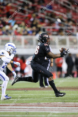 Stock Picture of UNLV Rebels tight end Noah Bean (46) catches the football during the NCAA football game featuring the Air Force Falcons and the UNLV Rebels at Sam Boyd Stadium in Las Vegas, NV. The UNLV Rebels lead the Air Force Falcons at halftime 21 to 20