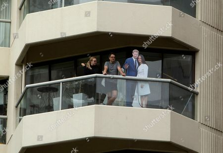 Royal fans display a cardboard cut out on their balcony of Britain's Prince Harry and his wife Meghan Duchess of Sussex Megan during the opening of the enhanced ANZAC Memorial in Sydney