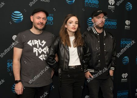 Iain Cook, Lauren Mayberry, Martin Doherty. Iain Cook, left, Lauren Mayberry and Martin Doherty of the band Chvrches visit the Radio 104.5 Performance Theater, in Philadelphia