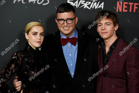 """Roberto Aguirre-Sacasa, Kiernan Shipka, Ross Lynch. Roberto Aguirre-Sacasa, center, creator and executive producer of """"Chilling Adventures of Sabrina,"""" poses with cast members Kiernan Shipka, left, and Ross Lynch at the premiere of the Netflix series, in Los Angeles"""