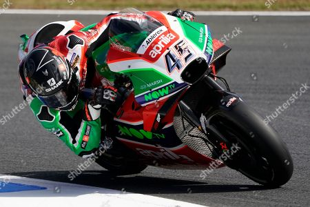 Stock Picture of England's Scott Redding steers his Aprilia during the free practice session for the MotoGP Japanese Motorcycle Grand Prix at the Twin Ring Motegi circuit in Motegi, north of Tokyo