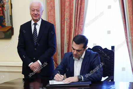 Greek Prime Minister Alexis Tsipras (R) signs documents following his swearing ceremony as new Foreign Minister by the country's President Prokopis Pavlopoulos (not pictured) at the presidential palace, after the resignation of former Foreign Minister Nikos Kotzias (not pictured)  in Athens, Greece, 20 October 2018. Tsipras took up the position after the resignation of former Foreign Minister Nikos Kotzias.