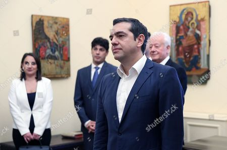 Greek Prime Minister Alexis Tsipras (2-R) is sworn in as the new Foreign Minister by the country's President Prokopis Pavlopoulos (not pictured) at the presidential palace in Athens, Greece, 20 October 2018. Tsipras took up the position after the resignation of former Foreign Minister Nikos Kotzias.