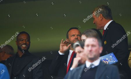 Manchester United Executive Vice Chairman Ed Woodward alongside former player Patrice Evra