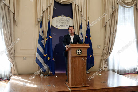 Greece's Prime Minister and newly appointed Foreign Minister Alexis Tsipras, addresses the audience during a handover ceremony in Athens, . Former Foreign Minister Nikos Kotzias resigned Wednesday following a disagreement with the defense minister over the handling of a deal for Greece to drop its objections to neighboring Macedonia joining NATO if the small country's name is changed