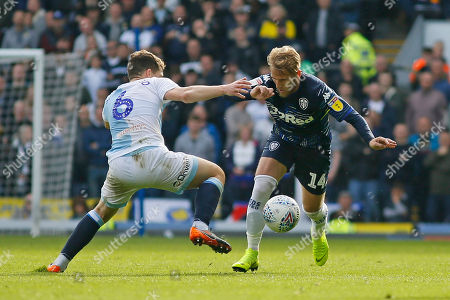 Leeds United midfielder Samu Saiz (14) goes past Blackburn Rovers Richard Smallwood  during the EFL Sky Bet Championship match between Blackburn Rovers and Leeds United at Ewood Park, Blackburn