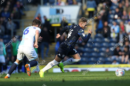 Leeds United midfielder Samu Saiz (14) gets away from Blackburn Rovers midfielder Richard Smallwood (6) during the EFL Sky Bet Championship match between Blackburn Rovers and Leeds United at Ewood Park, Blackburn
