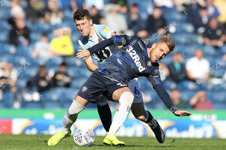 Leeds United midfielder Samu Saiz (14) and Blackburn Rovers midfielder Richard Smallwood (6) during the EFL Sky Bet Championship match between Blackburn Rovers and Leeds United at Ewood Park, Blackburn