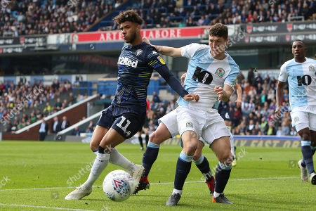 Leeds United forward Tyler Roberts (11) and Blackburn Rovers midfielder Richard Smallwood (6) during the EFL Sky Bet Championship match between Blackburn Rovers and Leeds United at Ewood Park, Blackburn