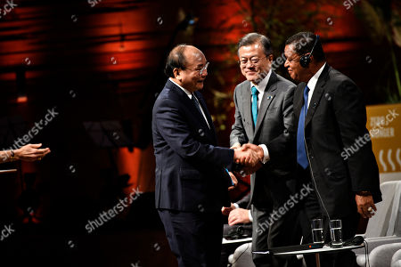 Prime Minister of Vietnam Nguyen Xuan Phuc (L) welcomes President of Korea Moon Jae-in (C) and President of Ethiopia Mulatu Teshome (R) after his speech on day two of the P4G Summit at the DR Koncerthuset in Copenhagen, 19 October 2018. P4G stands for Partnership for Green Growth and the Global Goals 2030 and is a global initiative which Denmark, along with South Korea, Ethiopia, Vietnam, Chile, Mexico and Kenya are involved in.