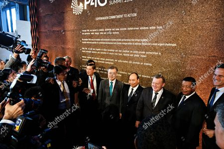President of South Korea Moon Jae-in (5-R), Prime Minister of Vietnam Nguyen Xuan Phuc, Prime Minister of Denmark Lars Loekke Rasmussen, President of Ethiopia Mulatu Teshome pose for a photo after signing the P4G agreement during day two of the P4G summit at the DR Koncerthuset in Copenhagen, 19 October 2018. P4G stands for Partnership for Green Growth and the Global Goals 2030 and is a global initiative which Denmark, along with South Korea, Ethiopia, Vietnam, Chile, Mexico and Kenya are involved in.