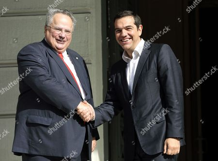 Greek outgoing Foreign Minister Nikos Kotzias (L) greets the Prime Minister and newly appointed Foreign Minister Alexis Tsipras (R) during a handover ceremony at the Foreign Ministry in Athens, Greece, 20 October 2018. Tsipras took up the position after the resignation of Kotzias following a disagreement with Defense Minister Panos Kammenos over the handling of a deal of Greece with FYROM.