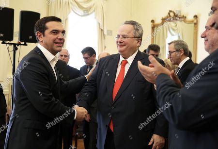 Greek Prime Minister and newly appointed Foreign Minister Alexis Tsipras (L) greets outgoing Foreign Minister Nikos Kotzias (R) during a handover ceremony at the Foreign Ministry in Athens, Greece, 20 October 2018. Tsipras took up the position after the resignation of Kotzias following a disagreement with Defense Minister Panos Kammenos over the handling of a deal of Greece with FYROM.