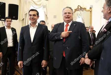 Greek Prime Minister and newly appointed Foreign Minister Alexis Tsipras (L) stands next to outgoing Foreign Minister Nikos Kotzias (R) during a handover ceremony at the Foreign Ministry in Athens, Greece, 20 October 2018.  Tsipras took up the position after the resignation of Kotzias following a disagreement with Defense Minister Panos Kammenos over the handling of a deal of Greece with FYROM.