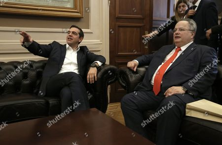 Stock Photo of Greek outgoing Foreign Minister Nikos Kotzias (R) talks with Prime Minister and newly appointed Foreign Minister Alexis Tsipras (L) during a handover ceremony at the Foreign Ministry in Athens, Greece, 20 October 2018. Tsipras took up the position after the resignation of Kotzias following a disagreement with Defense Minister Panos Kammenos over the handling of a deal of Greece with FYROM.