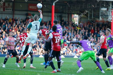 Brentford's Goalkeeper Daniel James Bentley punches clear during the EFL Sky Bet Championship match between Brentford and Bristol City at Griffin Park, London