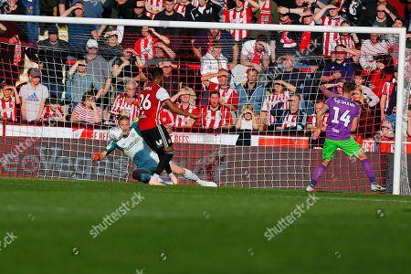Brentford's Goalkeeper Daniel James Bentley saves Brentford's Defender Ezri Konsa embarrasment during the EFL Sky Bet Championship match between Brentford and Bristol City at Griffin Park, London