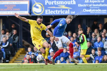 Fleetwood Town Defender, Craig Morgan (20) blocks Portsmouth Midfielder, Ronan Curtis (11) during the EFL Sky Bet League 1 match between Portsmouth and Fleetwood Town at Fratton Park, Portsmouth