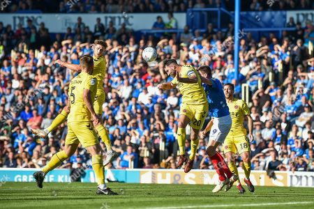 Fleetwood Town Defender, Craig Morgan (20) with a headed clearance during the EFL Sky Bet League 1 match between Portsmouth and Fleetwood Town at Fratton Park, Portsmouth
