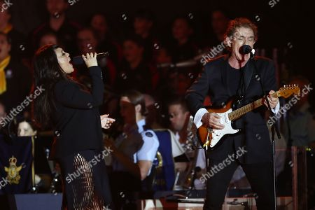 Stock Picture of Australian singer-songwriters Kate Ceberano (L) and Ian Moss (R) perform on stage during the Invictus Games opening ceremony in Sydney, Australia, 20 October 2018. The Sydney Invictus Games, at which wounded or sick armed services personnel and veterans will compete, will run from 20 to 27 October 2018.
