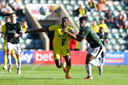 Lucas Akins (10) of Burton Albion battles for possession with Ashley Smith-Brown (23) of Plymouth Argyle during the EFL Sky Bet League 1 match between Plymouth Argyle and Burton Albion at Home Park, Plymouth