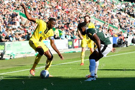 Lucas Akins (10) of Burton Albion looks for a way past Ashley Smith-Brown (23) of Plymouth Argyle during the EFL Sky Bet League 1 match between Plymouth Argyle and Burton Albion at Home Park, Plymouth