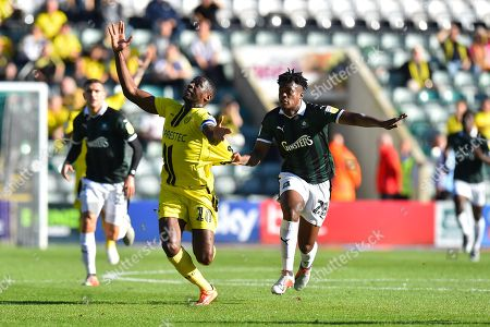 Lucas Akins (10) of Burton Albion has his shirt pulled by Ashley Smith-Brown (23) of Plymouth Argyle during the EFL Sky Bet League 1 match between Plymouth Argyle and Burton Albion at Home Park, Plymouth