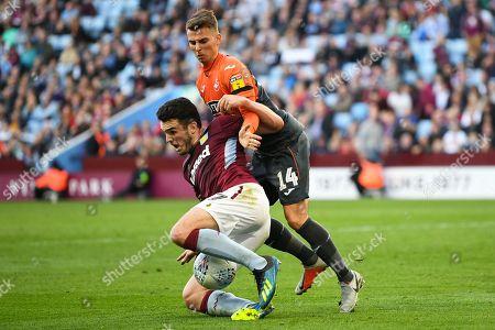 John McGinn of Aston Villa goes down under the challenge of Tom Carroll of Swansea City
